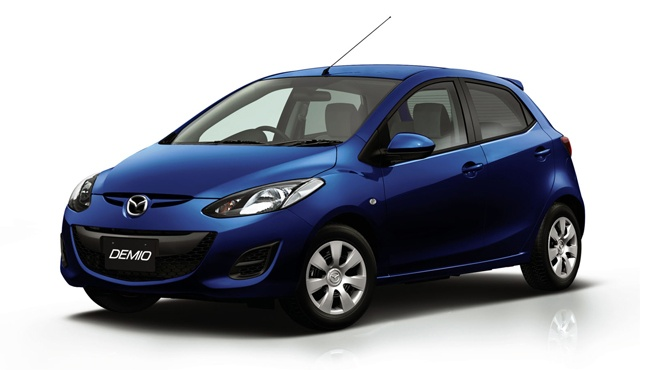 Blue Mazda Demio an example of a Pegasus sub-compact car for hire